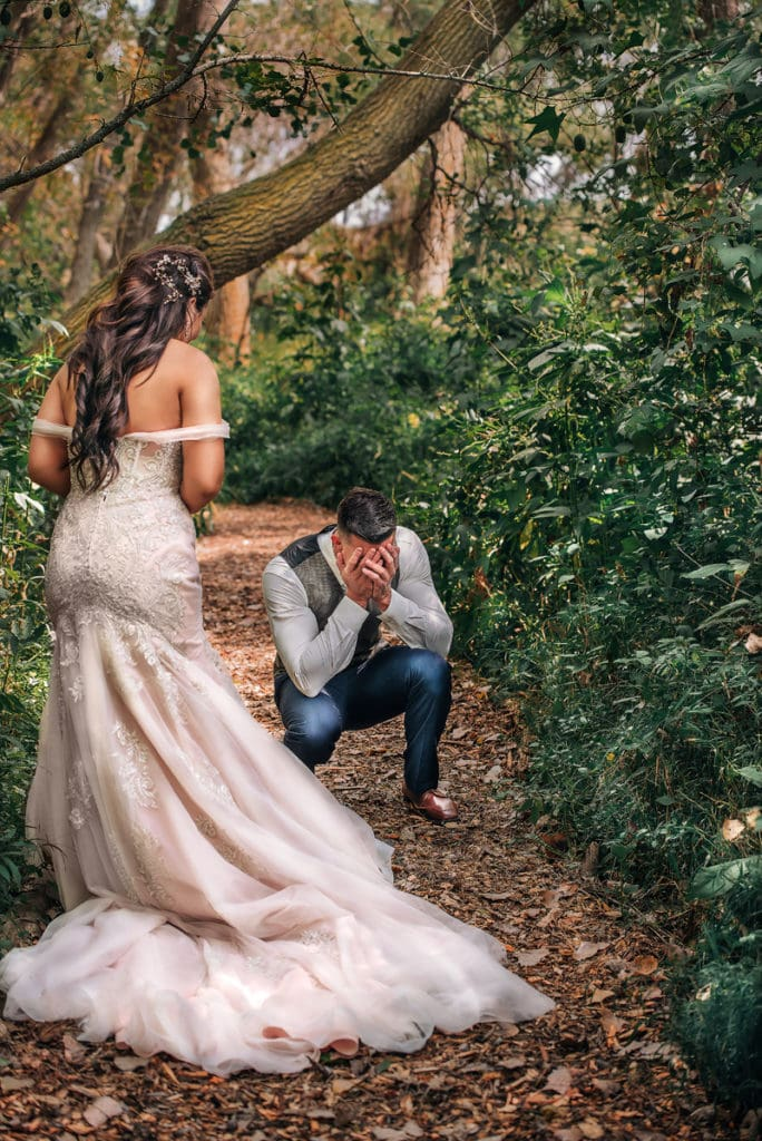 NE Family Photographer, groom's first look at bride, kneeling down and crying